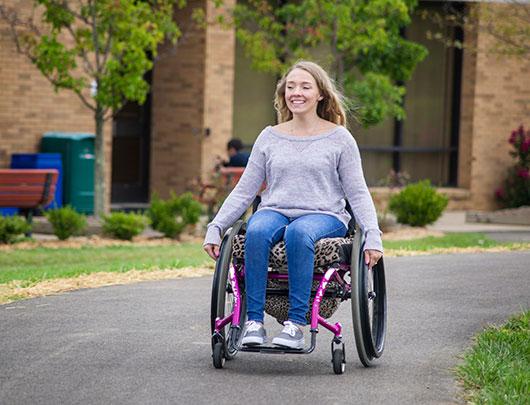 Woman-gliding-down-a-path-in-a-wheelchair