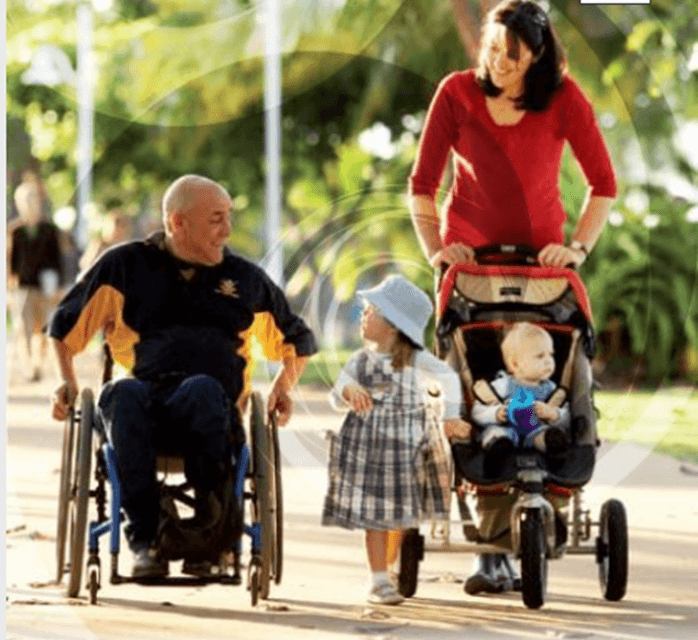 family using wheelchair and stroller