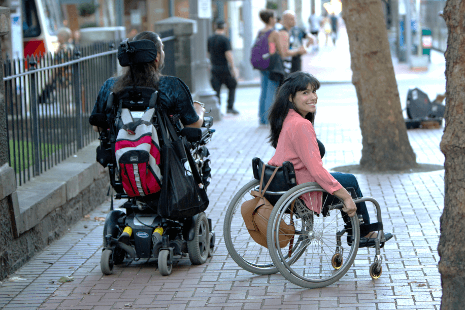 Power Chair and manual chair users on the street