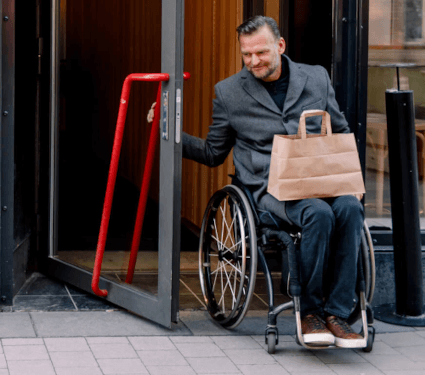 Shopper in wheelchair exiting store